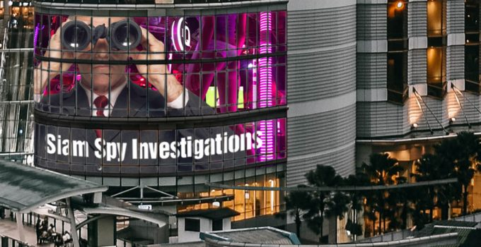 Siam Spy - Thailand private investigator, display on a giant screen TV in downtown Bangkok
