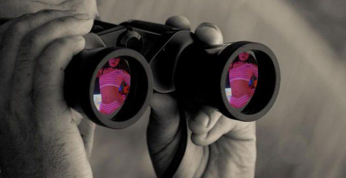Thailand private investigator job, an investigator looking through binoculars